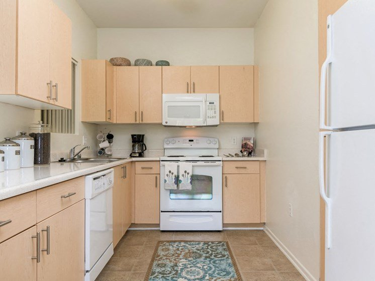 Chef-Inspired Kitchens Feature Stainless Steel Appliances at Greenfield Village, San Diego, CA