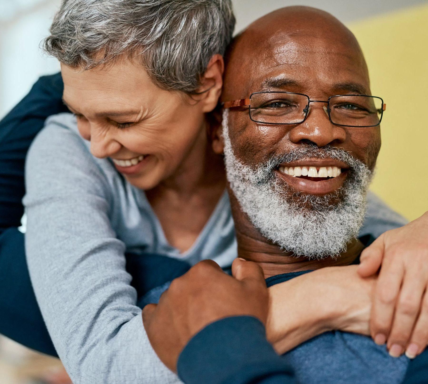 Elderly woman embracing an elderly man in a hug