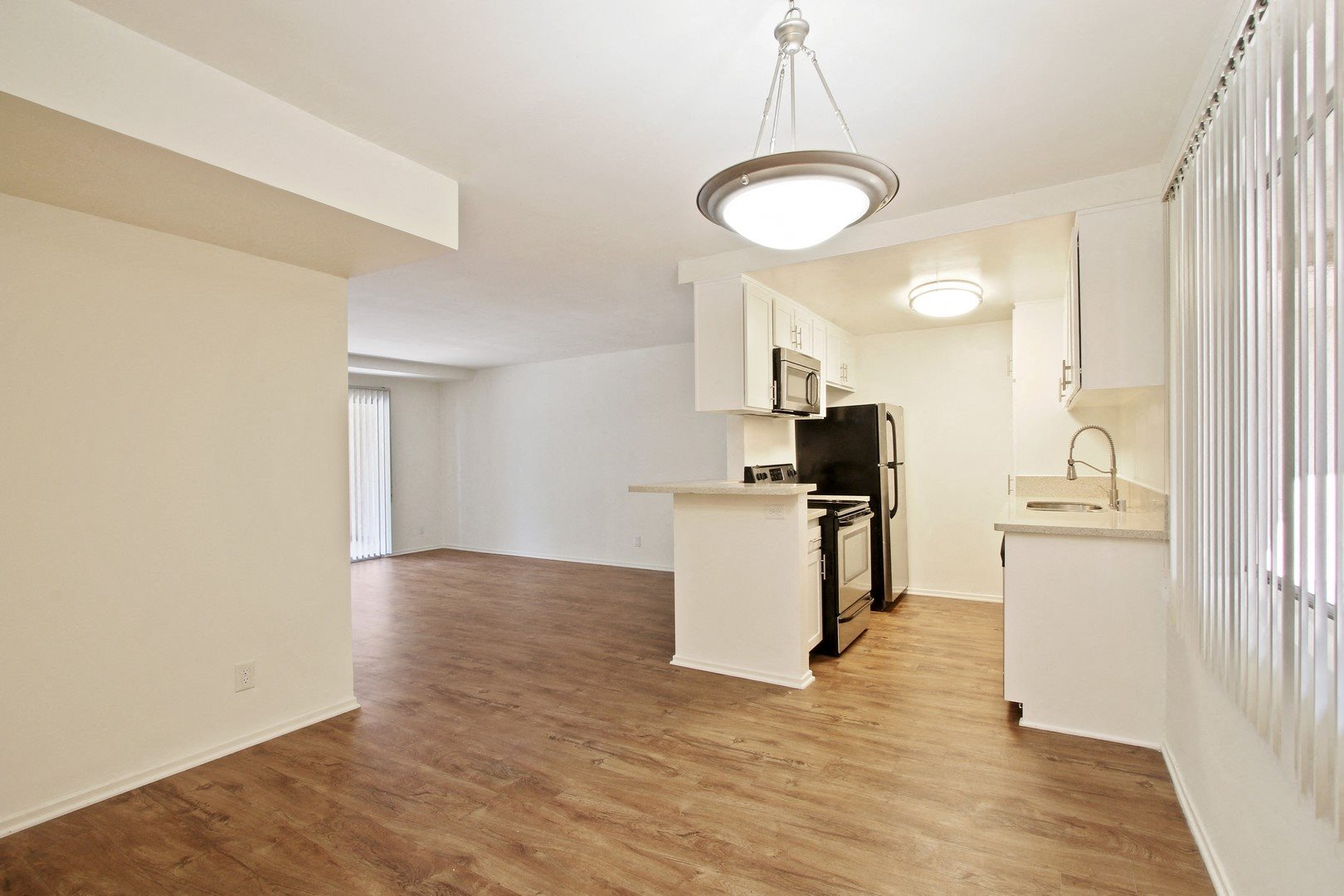 Dining room with wood Inspired flooring