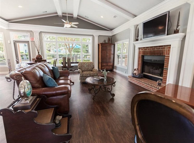 large clubhouse with fireplace and comfortable furnishings
