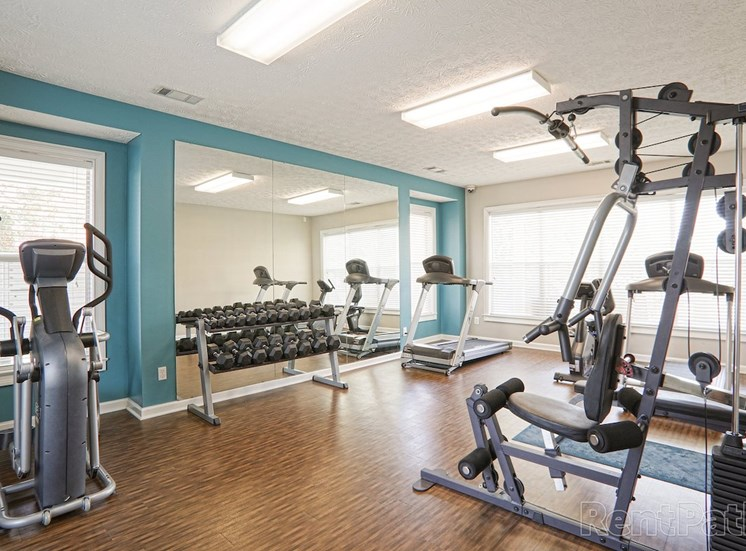 fitness center with cardio and strength training equipment at The Point at Fairview Apartments, Prattville, 36066