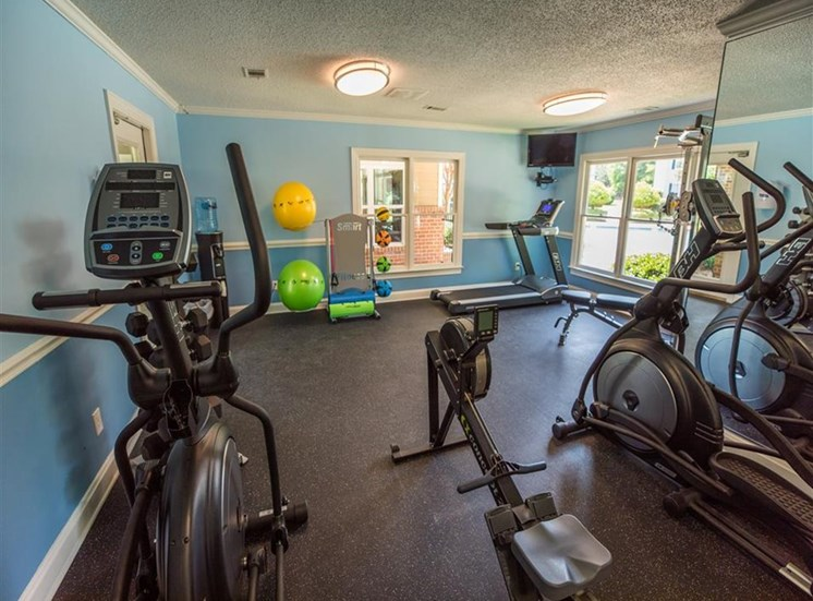 cardio equipment and yoga/stretching balls and mats in fitness center