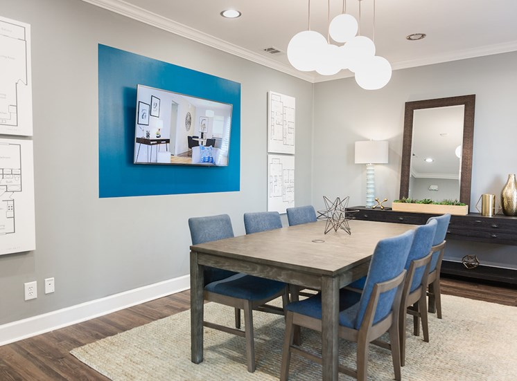 conference center in clubhouse with tv on wall and large conference table at The Jameson Apartments, Homewood, AL, 35209