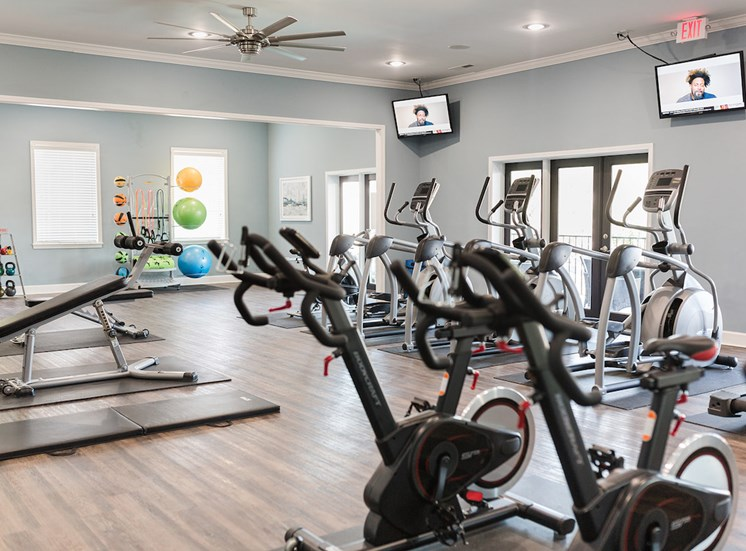 Fitness center with spin bikes,  elliptical bikes, and weight bench at The Jameson Apartments, Alabama, 35209