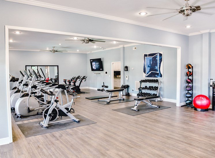 expansive fitness center with cardio machines and free weights at The Jameson Apartments, Homewood, AL, 35209