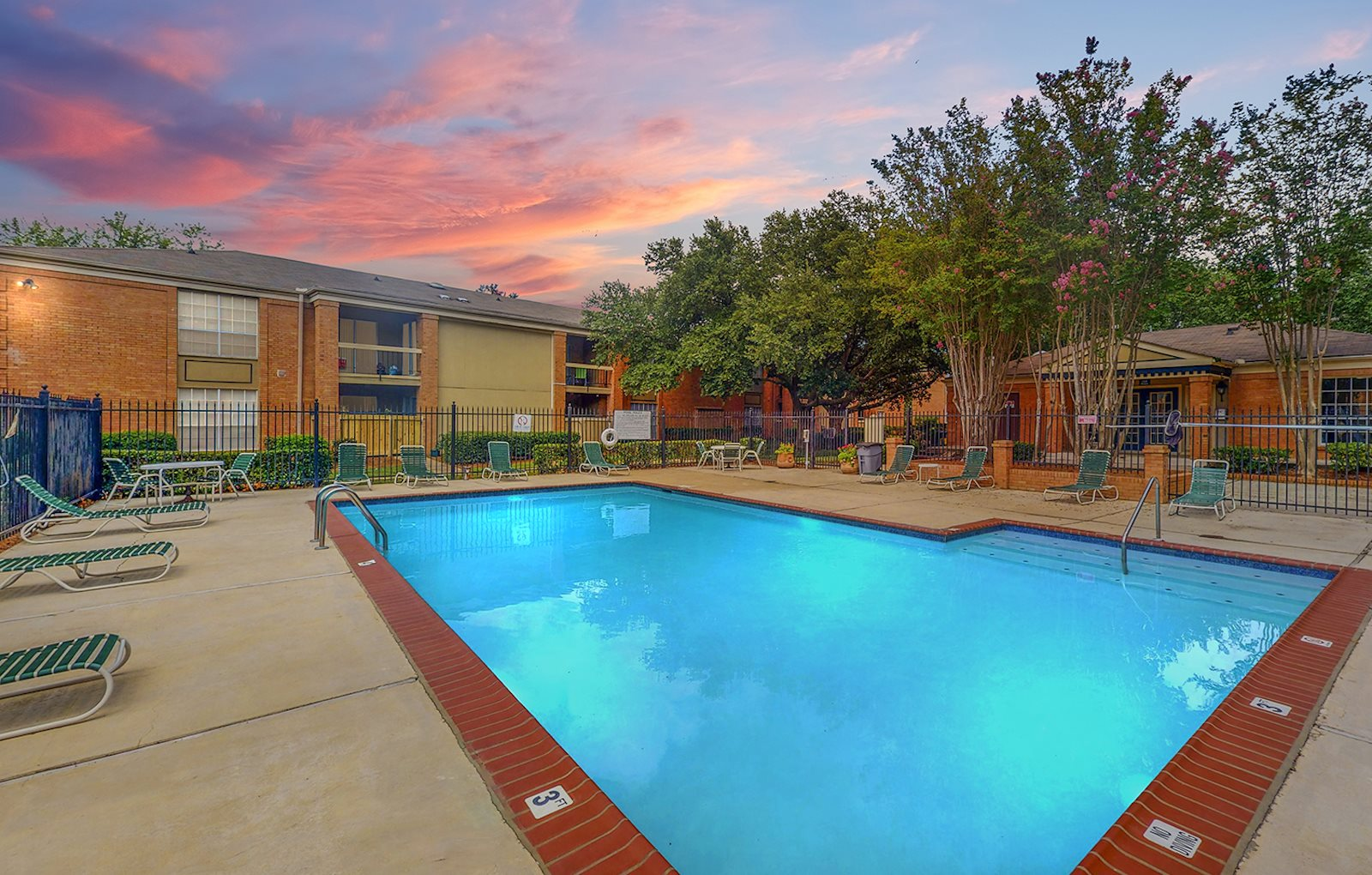 Swimming pool and large sundeck at sunset