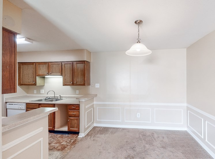 dining area with overhead lighting beside kitchen at Hampton House Apartments, Jackson, MS, 39211