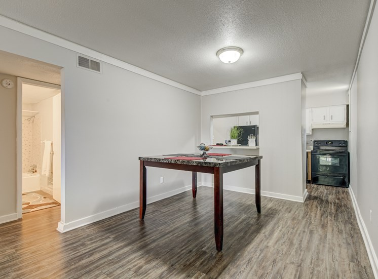 dining area beside kitchen with hardwood-style flooring at Reserve at Midtown Apartments, Florida