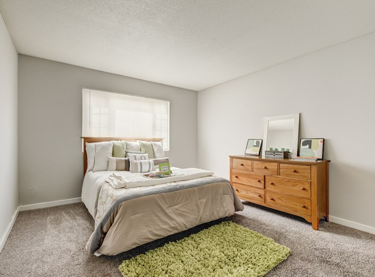 bedroom with large window, plush carpet, and model furniture at Reserve at Midtown Apartments, Florida, 32303