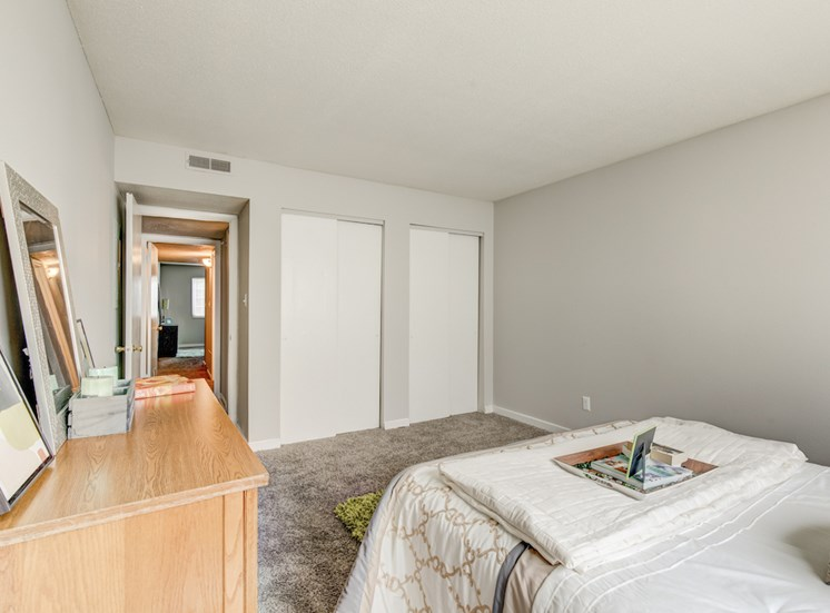 bedroom with large closet, model furnishings, and plush carpeting at Reserve at Midtown Apartments, Tallahassee
