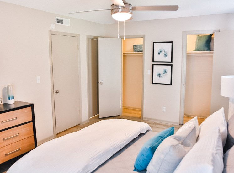 model bedroom with modern ceiling fan and large closets