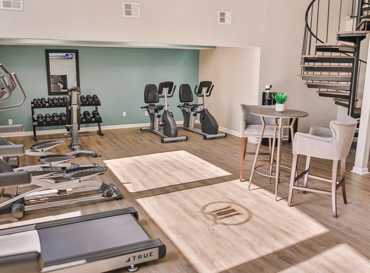 Fitness center with cardio stations and free weights