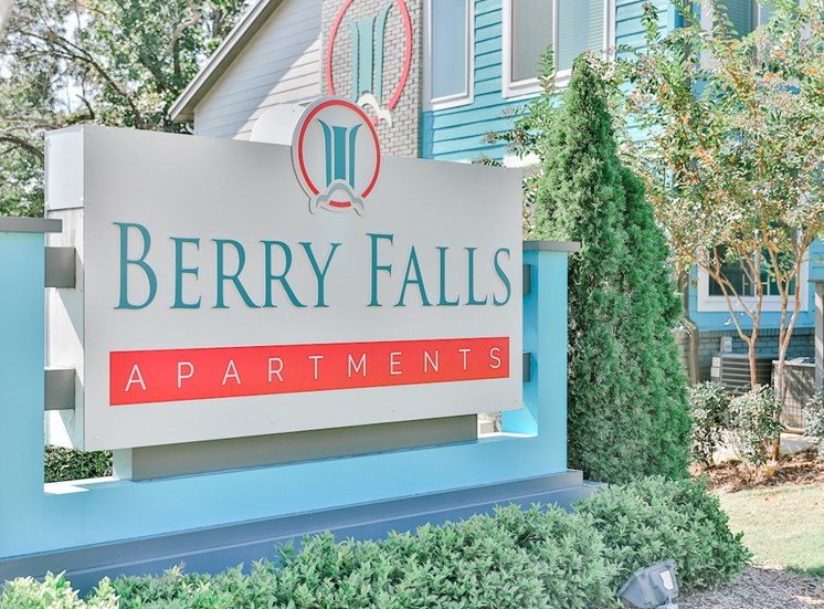 berry falls apartments sign with lush landscaping