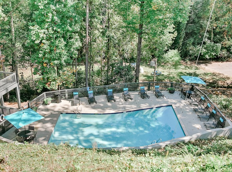 Berry Falls pool and sundeck surrounded by wooded landscape