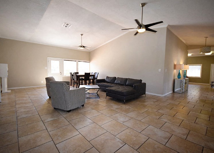 large community room with vaulted ceilings and tile floors
