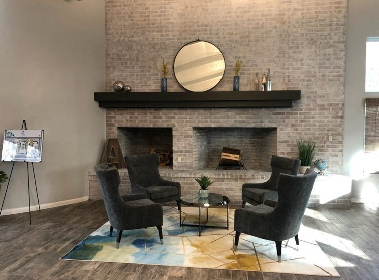 large fireplace with arm chairs in aspen run clubhouse