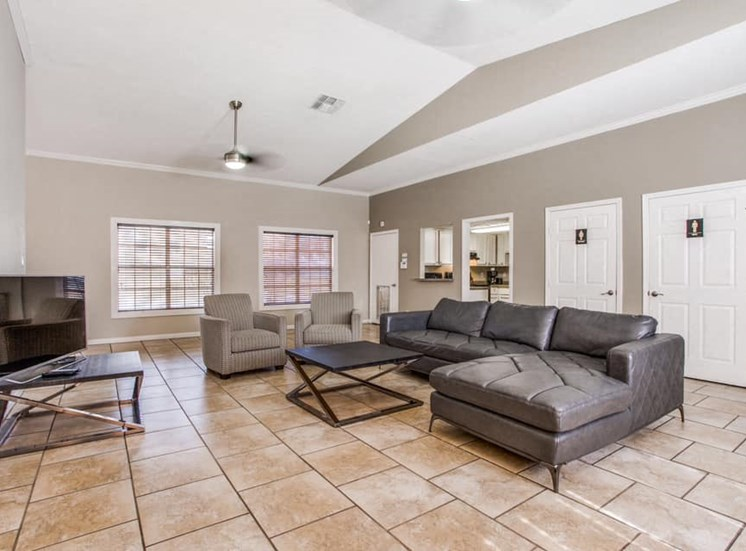 large community room with comfortable seating and tile floors