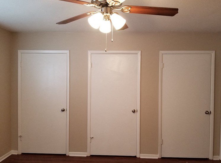 doors in master bedroom leading to closet, bathroom, and exit