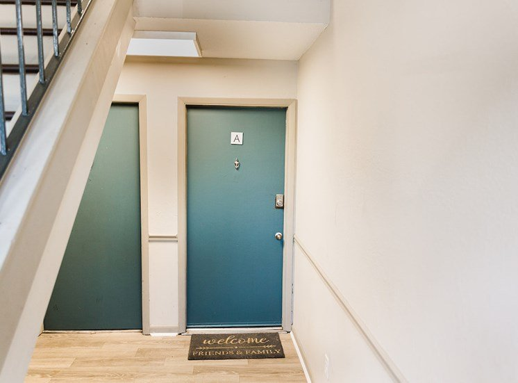Outside doors to apartments with staircase leading to upper floors at The Jameson Apartments, Alabama, 35209