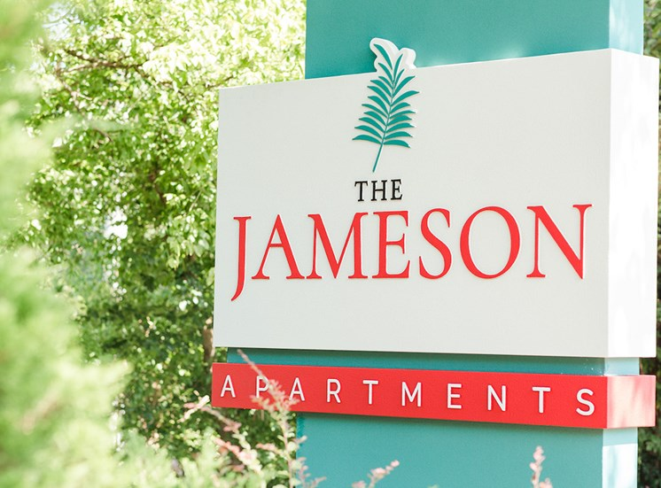 Outside signage stating The Jameson Apartments surrounded by trees at The Jameson Apartments, Homewood, 35209