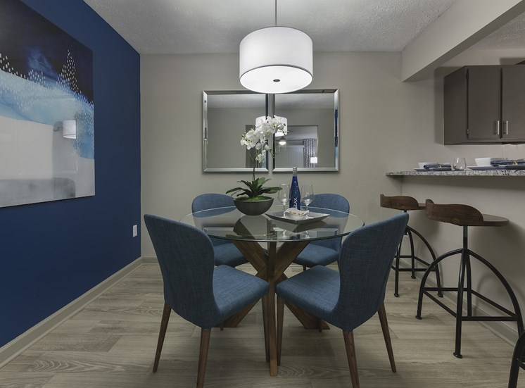 Separate dining room with hardwood style floors and pendant lighting at The Retreat at Lakeland Apartments, Lakeland, FL, 33809
