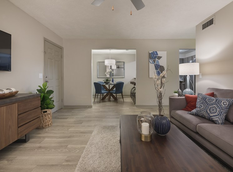 Living room and separate dining room with hardwood-style floors throughout at The Retreat at Lakeland Apartments, Lakeland, Florida