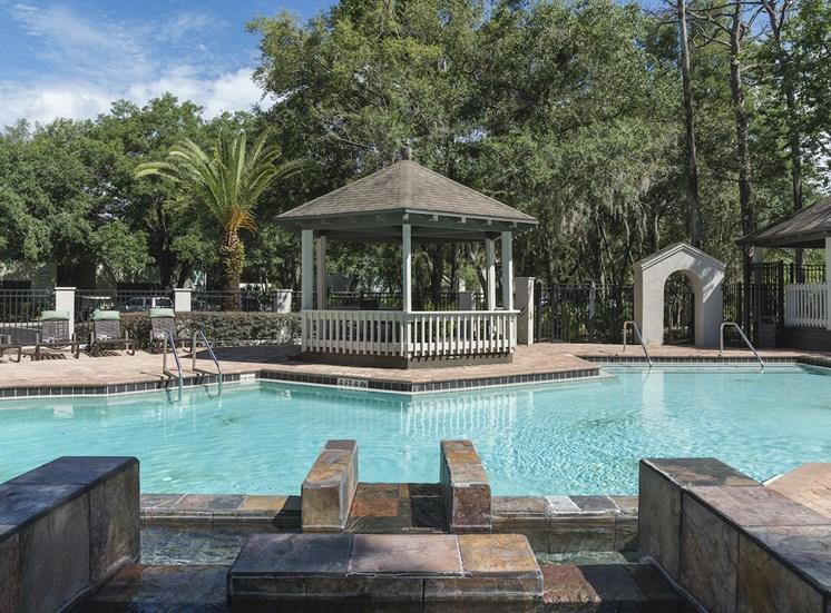 large swimming pool with water fall and gazebo at The Retreat at Lakeland Apartments, Lakeland, 33809