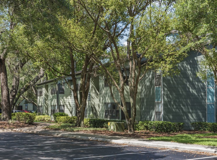 ample shaded parking in front of apartment buildings at The Retreat at Lakeland Apartments, Lakeland, 33809