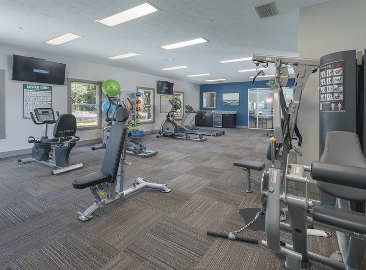 fitness center with cardio and strength training equipment at The Retreat at Lakeland Apartments, Lakeland, 33809