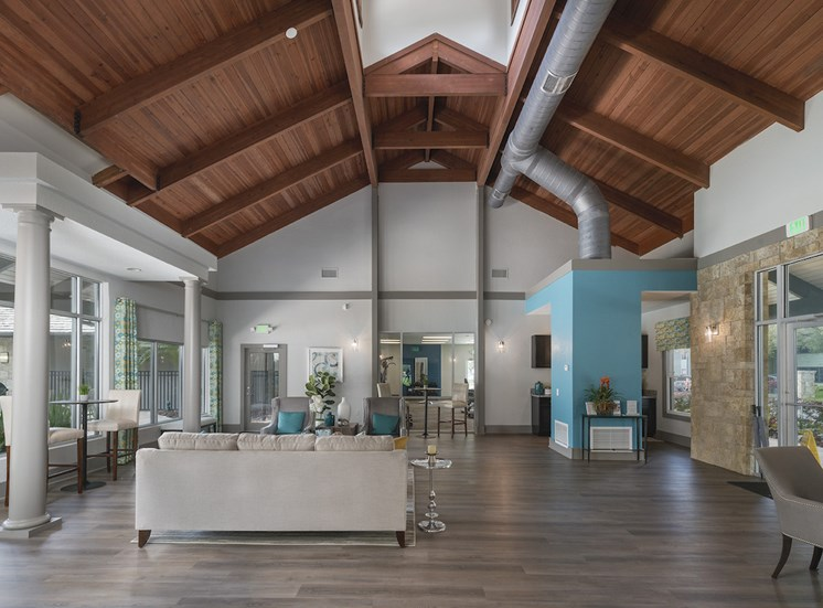 lobby with seating, coffee bar, and leasing at The Retreat at Lakeland Apartments, Lakeland, FL, 33809