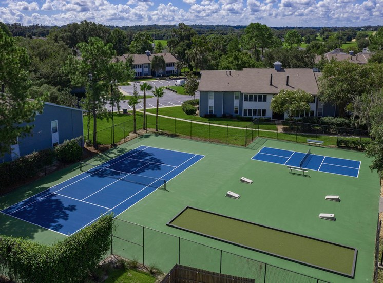 sports court with tennis, pickle ball, and cornhole