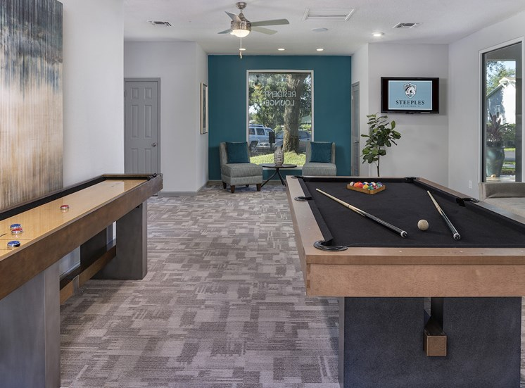resident lounge with seating, tv, shuffleboard table and pool table