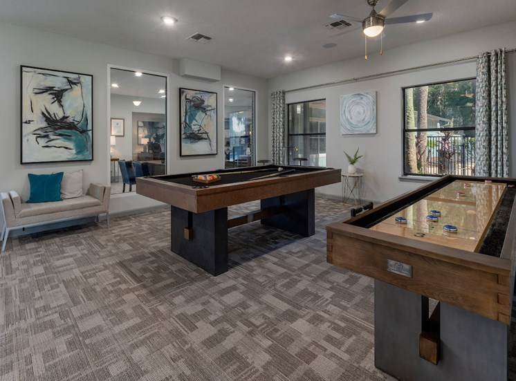 Resident lounge with pool and shuffleboard tables