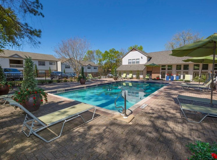 pool and sundeck with lounge chairs at Aspen Run Apartments