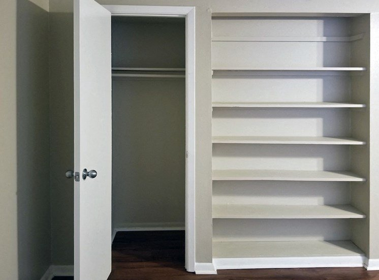 Pantry with built-in shelving and closet at Aspen Run