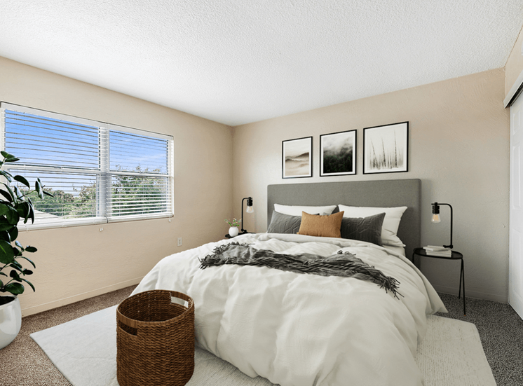 Virtually staged bedroom with floor rug, bed, night stands, desk lamps, wall art, and large window for natural lighting