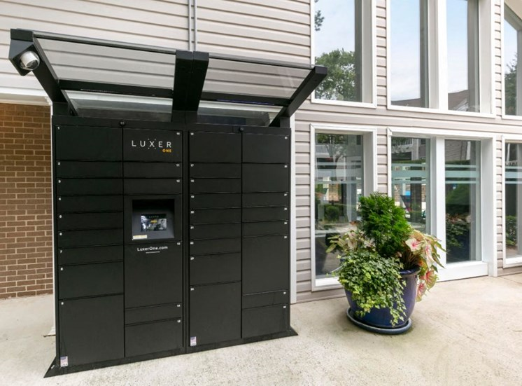 Package Cache Lockers Next to Leasing Office Exterior with Pants