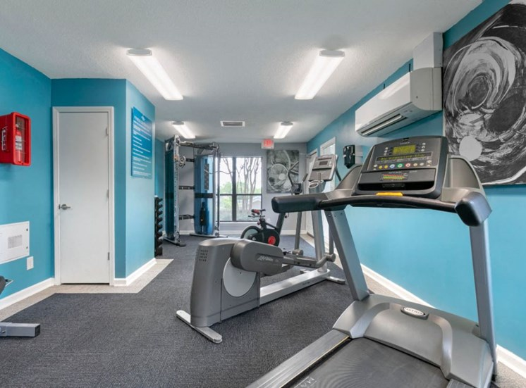 Fitness Center with Exercise Equipment and Blue Accent Wall