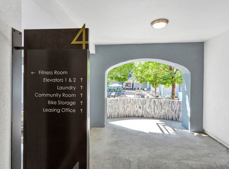 Breezeway with Directional Sign Attached to Wall