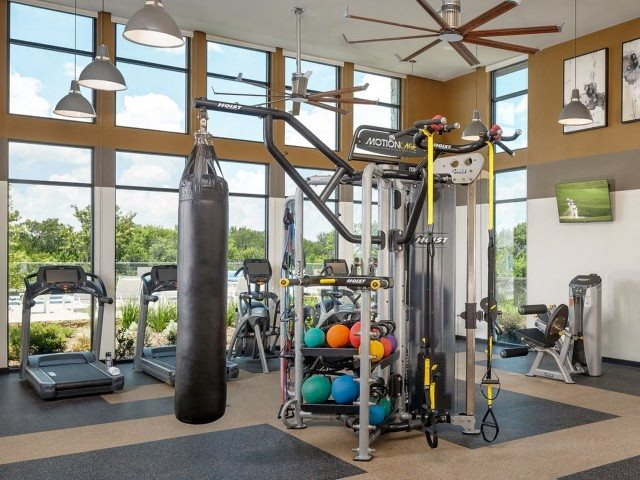 Fitness Center with large spacious windows, kickboxing station, and treadmill
