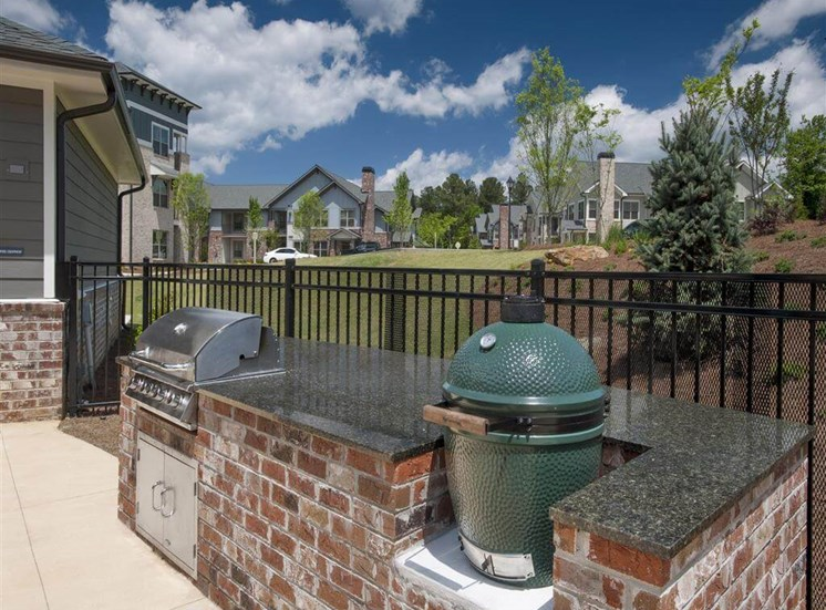 Pool Grilling Station in Summer Kitchen Next to Fence