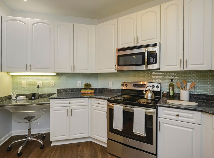 Kitchen with stainless steel appliances. Built in microwave