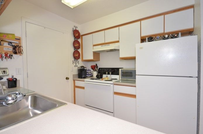 Kitchen With White Appliances at River Park Place Apartments, Vero Beach, Florida