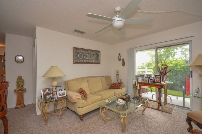 Decorated Living Room With Natural Light at River Park Place Apartments, Florida