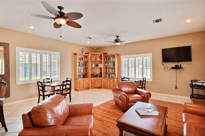Luxurious Clubhouse With Television at River Park Place Apartments, Vero Beach, FL