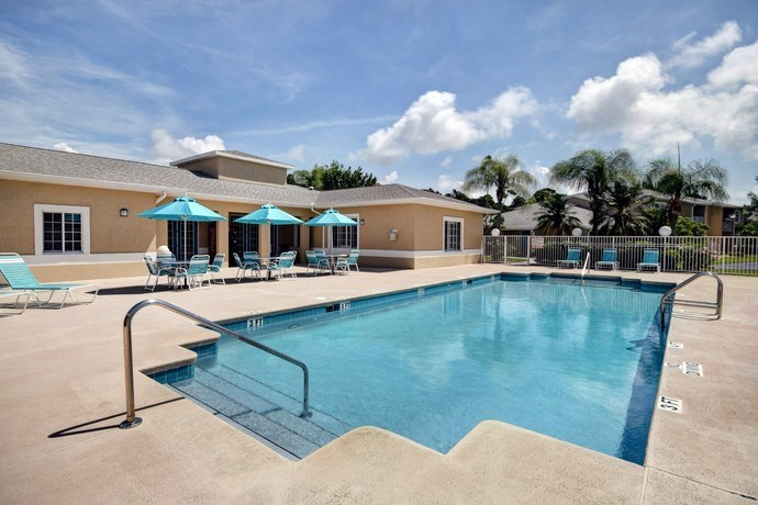 Pool Side Relaxing Area With Sundeck at River Park Place Apartments, Vero Beach, Florida
