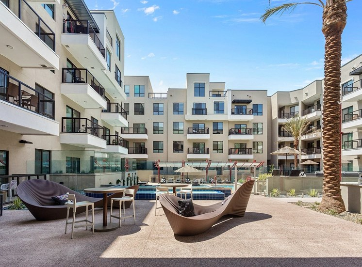 Outdoor Seating with Contemporary Patio Chairs on Sundeck Surrounded by Buildings