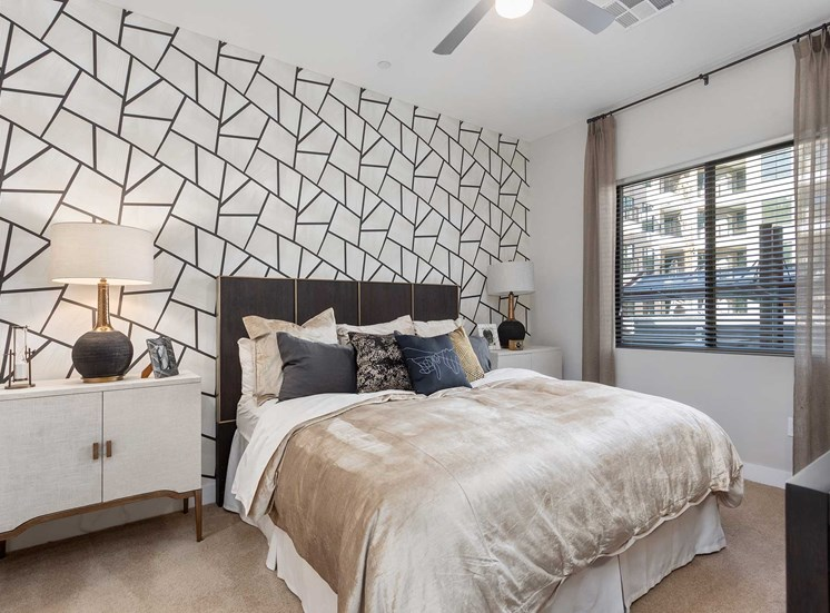 Model Bedroom with Accent Wall  Bed with Headboard, Dresser, Nightstands and Decorations