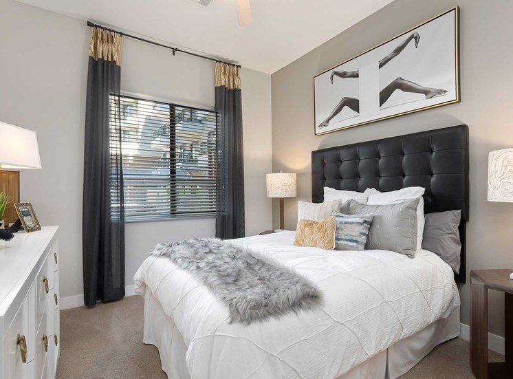Model Bedroom with Bed with Headboard, Dresser, Nightstands and Decorations