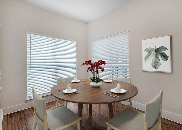 Dining room with round table and windows